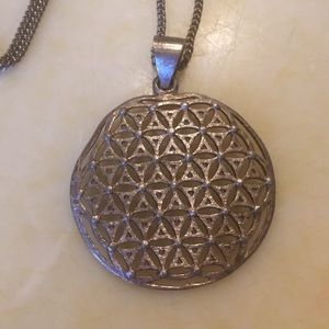 Sterling silver flower of life pendant and chain.